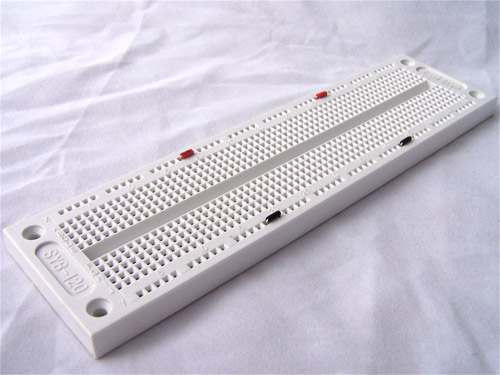 breadboard with jumpers on power buses